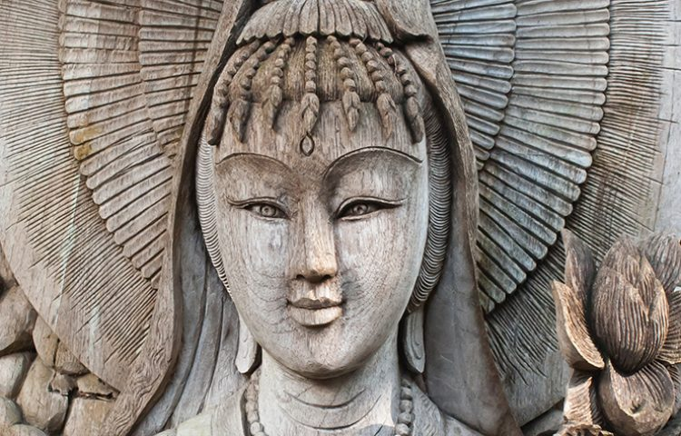 Kuan Yin image of buddha , Wood carving in Thailand